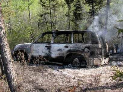 Автомобиль с соженными останками смотрящих