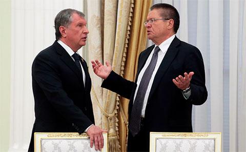 Слева: Игорь Сечин и Алексей Улюкаев