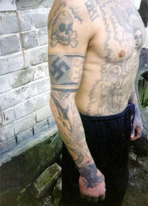 Татуировка со свастикой фото