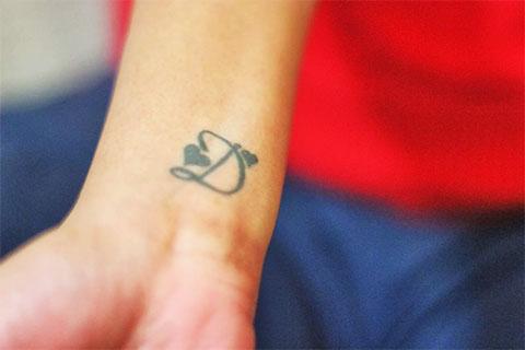 Татуировка - буква д в сердце (фото)
