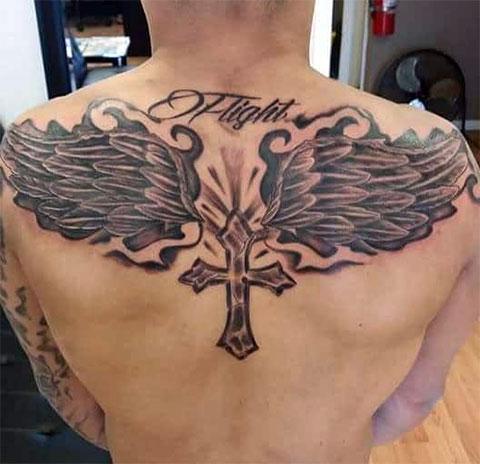 Тату крест с крыльями и надписью
