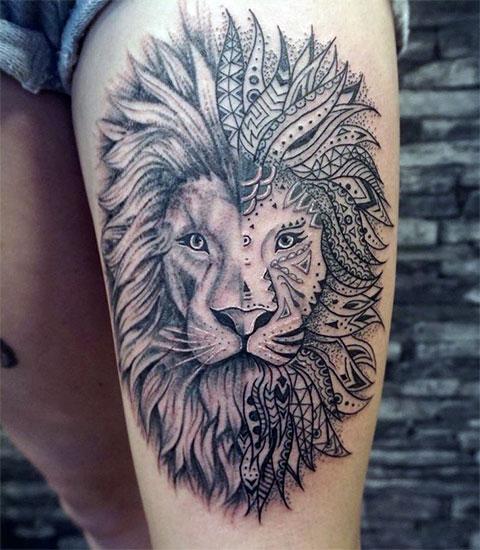 Женская татуировка льва на бедре