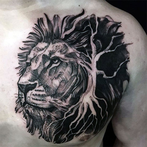 Лев на груди - фото тату