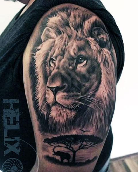 Мужская татуировка со львом на руке