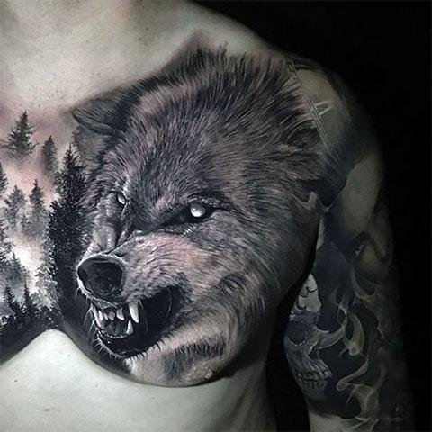 Тату оскал волка на левой груди