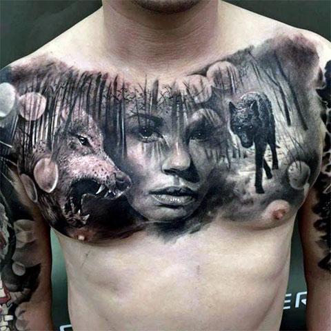 Сюжетная тату с волками на груди