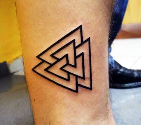 Тату символы на ноге