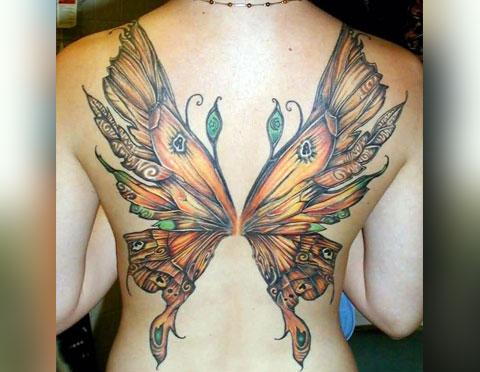Тату крылья у девушки на спине