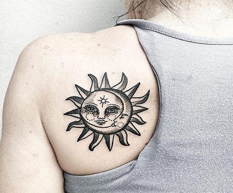 Тату черное солнце с луной