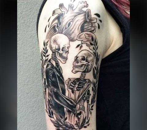 Татуировка влюбленные скелеты