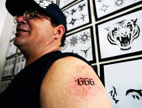 Тату 666 на плече - фото