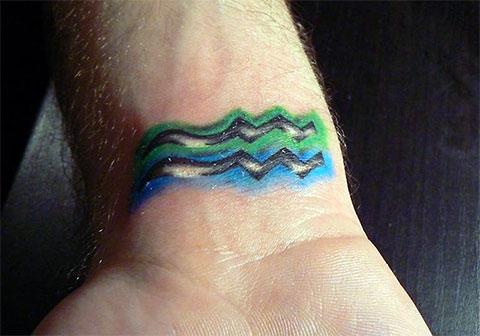 Татуировка знак водолея-акварель