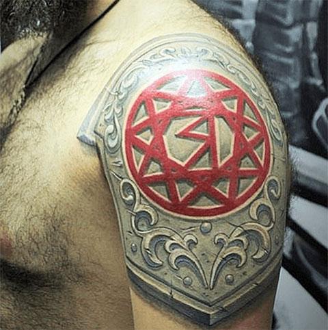 Татуировка звезда Руси на плече