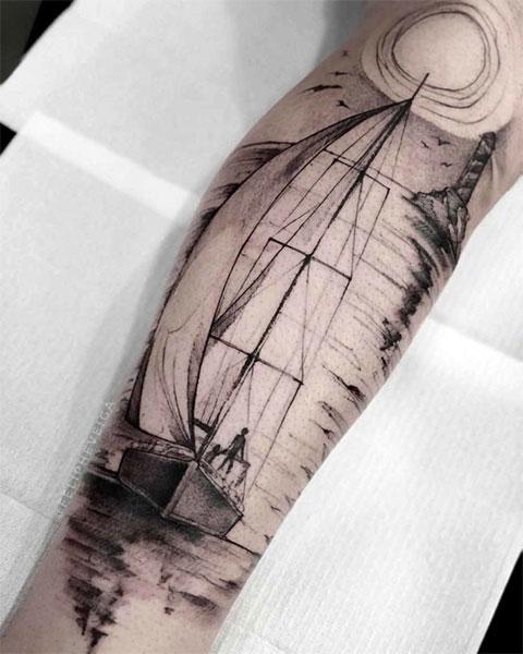 Тату лодка с парусами на ноге