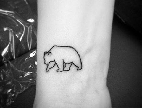 Тату белый медведь минимализм