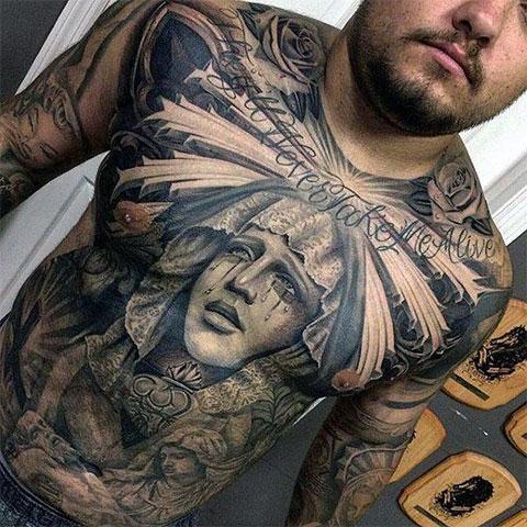 Татуировка Божья Матерь на животе