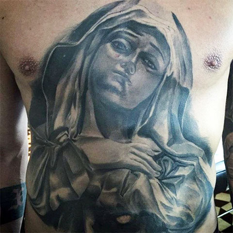Тату Божьей Матери на груди и животе - фото
