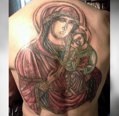 Тату икона Божьей Матери с младенцем на спине - фото