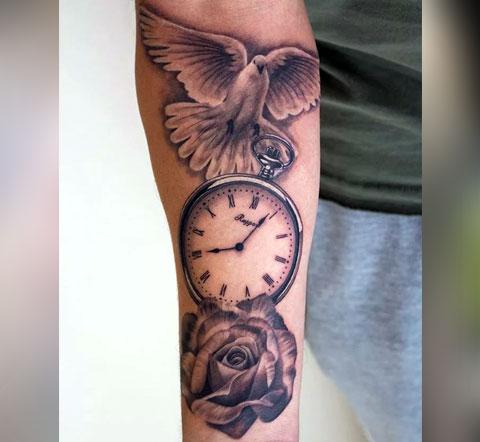 Тату на руке - часы с голубем