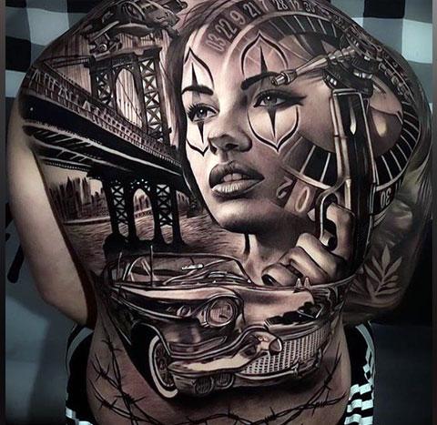 Татуировка в стиле Чикано на спине мужчины - фото