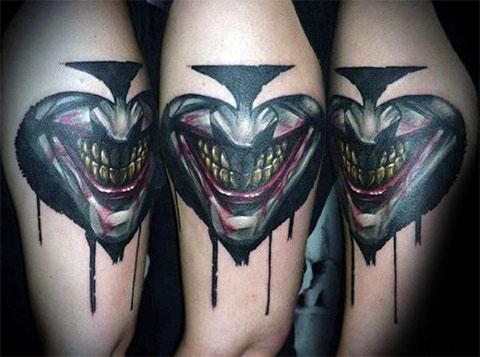 Тату улыбка Джокера - фото