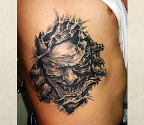 Мужская татуировка с демоном