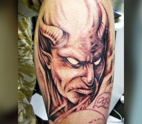 Татуировка с лицом дьявола