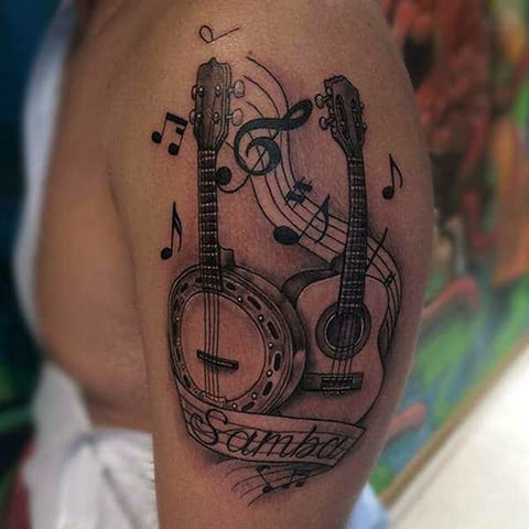Татуировка гитара и ноты