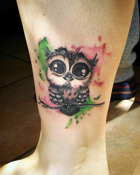 Татуировка с маленьким совенком - фото