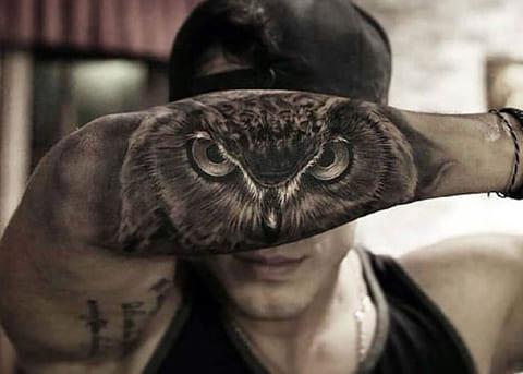 Тату с глазами совы на руке
