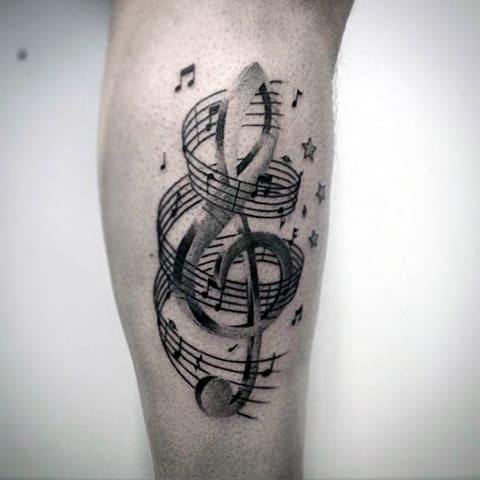 Татуировка ноты и скрипичный ключ