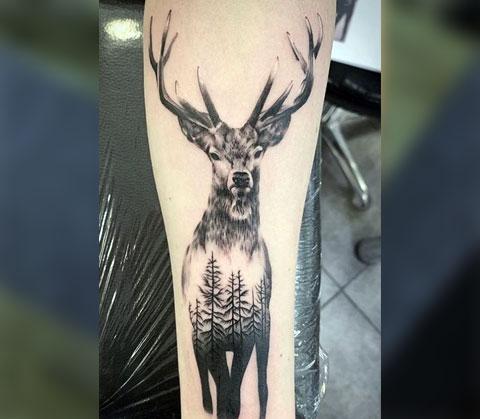 Татуировка с оленем