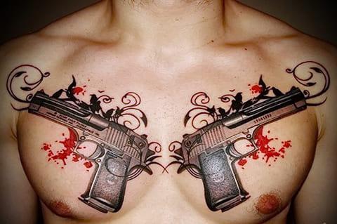 Тату с двумя пистолетами на груди