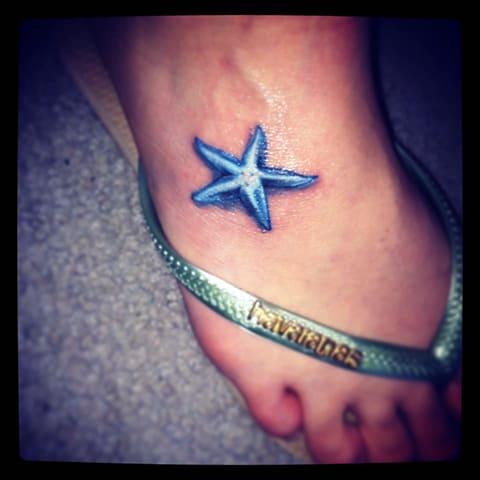 Тату морская звезда на ноге - фото