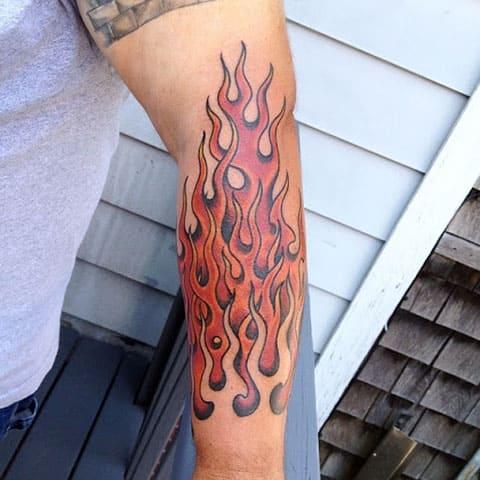 Тату огонь на руке - фото