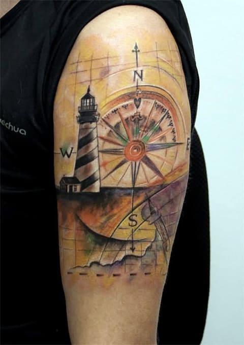 Тату маяк и компас