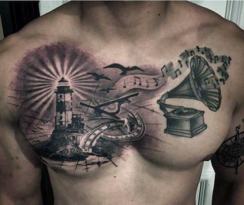 Тату маяк на грудине