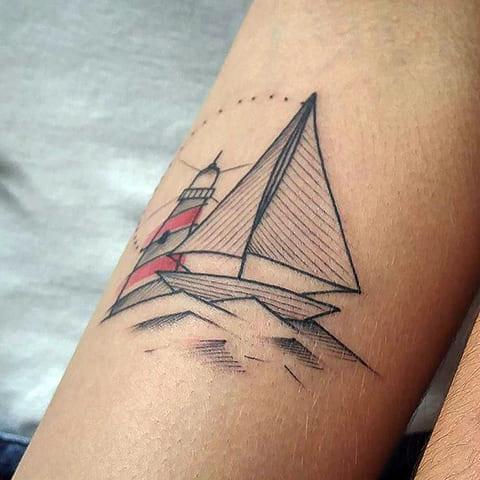 Тату маяк и корабль