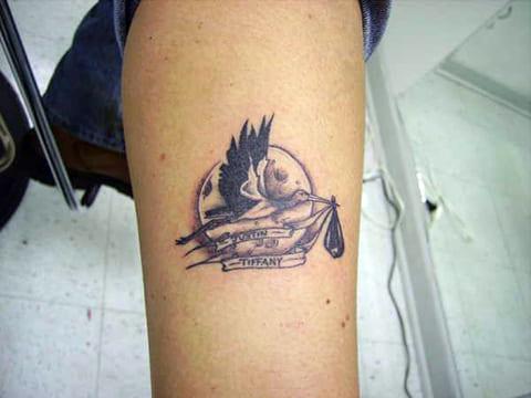 Татуировка с аист