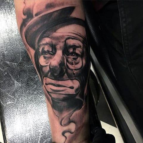 Тату грустный клоун