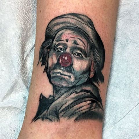 Тату грустный клоун - фото