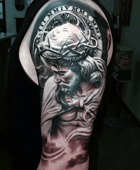 Татуировка Иисус Христос на плече