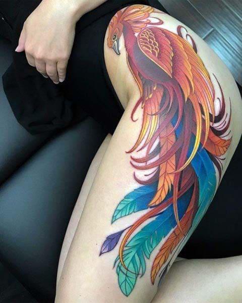 Татуировка жар птица на ноге у девушки - фото