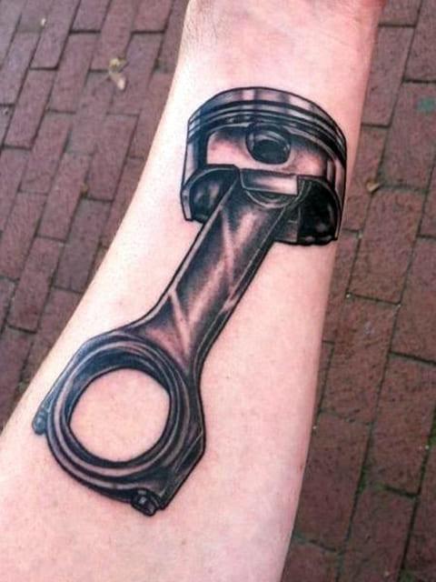Татуировка поршень - фото