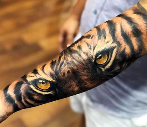 Тату глаза тигра