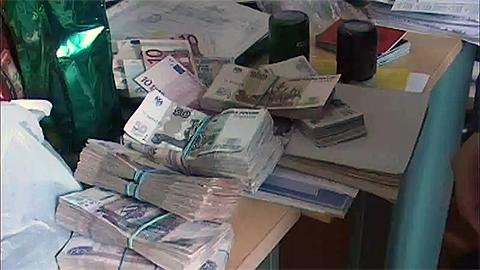 Найденные деньги в ходе обысков на рынках