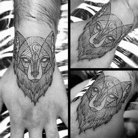 Тату на руку волк - геометрия