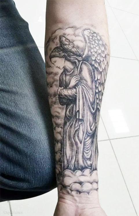 Тату ангел на руке - мужская татуировка